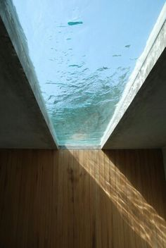 Glass ceiling with view of the ocean and Timber clad walls
