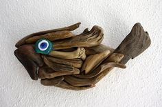 driftwood fish made from natural driftwood and glass bead by Yalos, $45.90
