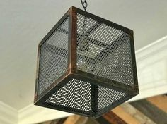 Industrial Steel Cube Pendant light Custom colors/finishes available. Ceiling canopy and mounting hardware included.Measures 12 x 12 x Shipping
