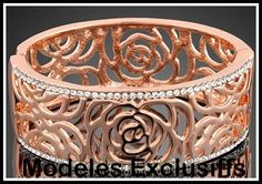 18K polished rose gold filigree bangle lined with crystals. One size fits all.