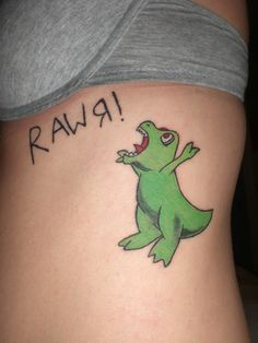 "Dinosaur cartoon tattoo, I would get a cute ""reptar"" tat. Because I grew up watching rugrats"