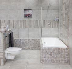 Our top tip for a trendy bathroom renovation is combining wood- and cement-look tiles for a naturally beautiful result. Design Trends, Wood, Tiles, Trendy Bathroom, Home Decor, Bathroom, Renovations, Bathroom Renovation, Trendy Home