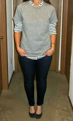 sweatshirt tee layered over striped shirt + skinny jeans