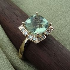 Antique Style Natural Light Green Amethyst with Diamonds Engagement Ring 14k Rose Gold Ring We designed and handmade this ring. The center is a approximately 9 mm cushion cut beautiful light green amethyst. With 16 side diamonds 1/4 Cts VS-SI clarity range. We can make it any size from 5-7 and you still be able to return it within the listed time frame. Sizing outside of that range requires a resize fee if for any reason the ring is retuned. Ring sizing may add additional handling time. ...