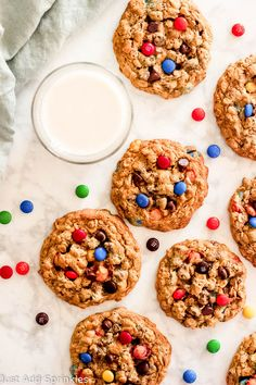 Huge Monster Cookies loaded with peanut butter, chocolate chips, oats, M&M candies and a little hit of cinnamon. They back up perfectly in about 15 minutes and have a perfect, soft, chewy cookie texture #justaddsprinkles #cookies #monstercookies