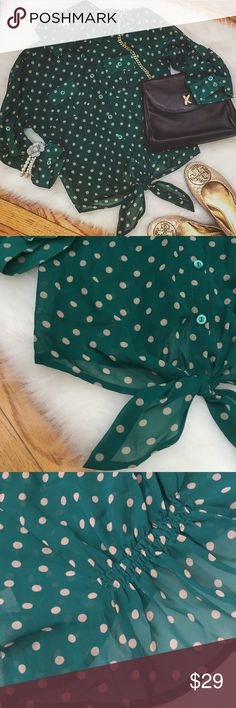 Mine... Polka Dot Crop Top This is the cutest sheer polka dot cropped top with a tie at the bottom in the front and pleats in the back. Rolled up half length sleeves. Two buttoned pockets in the front. I went to Michigan State and bought this shirt to wear to football games--the top was such a hit! Very gently worn, still in excellent condition. Mine... Tops Blouses
