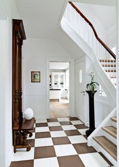 I love this brown and white foyer. Kitchen floor maybe?
