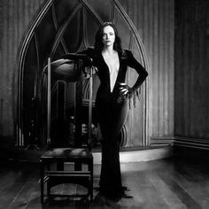This is a photoshop of Christina Ricci dressed as Morticia Addams but... hot damn.