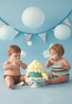 oh the sweet little chubs.....I posted this cupcake picture a while back....it must have been before they let the b-day twins dig in! ;-) love it.