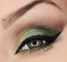Green shadow with black liner. Visit Beauty.com has liners, eye shadows and more.
