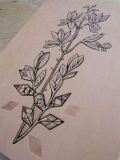 Tattooed leather art. Handmade. Inked with a tattoo machine. Original artwork. Geometric flower in gift box