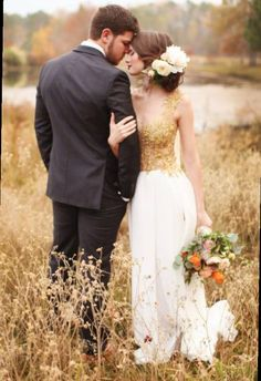 Love the different wedding dress and the big full flowers in her hair and bouquet.
