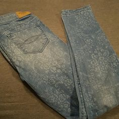 Abercrombie & Fitch Distressed Floral Skinny Jeans Excellent condition. Only worn twice. Super cute distressed floral pattern.  Outfit with white slim crop top. Abercrombie & Fitch Jeans Skinny