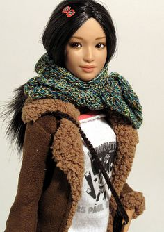 "I don't know who this is and by whom or what kind of doll she is, but this is the type I'd like to customize my fashion dolls to - natural, ""real"""