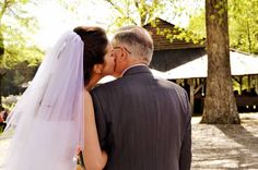 Spring Military Wedding The bride kisses her dad before she walks down the aisle... Colors: Blue & Orange @Amber S. Wallace Photography