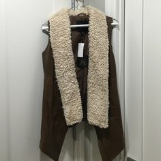 ✨NWT Jack by BB Dakota brown faux leather vest Brown vest with faux fur. Brown material looks like leather but is really polyester. Super comfortable and warm fur collar. Elevates any winter look! Jack by BB Dakota Jackets & Coats Vests