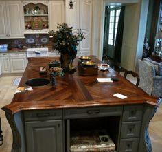 White Oak edge grain wood island countertop. Herringbone inaly pattern with custom stain and Waterlox Semi-gloss finish.