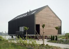 modern-barn-house-1.jpg Siding is REALLY cool. And like the metal roofing/siding material too, the way it wraps the building. and the raised floating effect.