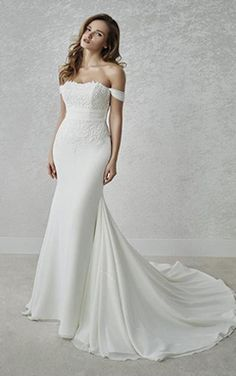 3bd4c6b3c884 Pronovias wedding gowns are renowned for their classic silhouettes and  touches of timeless glamour. View