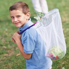 """Bug treasure hunt: Bring out the bug catchers for this game that will have even insect-shy kids wanting more. Hide little treasures, such as candy, coins, and small toys, around your yard. Send kids out with their butterfly nets searching for """"bugs."""" Use the nets to gather the finds."""