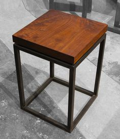 Unique custom steel and walnut end table designed and made by Rick & Tracey Bewley, owners of Art Fusion Studio.