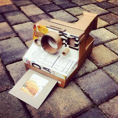 My husband made me this amazing Polaroid One Step out of cardboard. It's so freakin' cool! My own cardboard sculpture effort: Cardboard One Step Polaroid by the other Martin Taylor. Cardboard Sculpture, Cardboard Art, Sculpture Art, Sculptures, Polaroid One Step, Polaroid Camera, Class Projects, Art Projects, Cardboard Camera