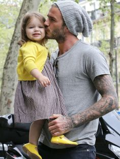 Harper Beckham & David Beckham. I normally don't think tatoos are hot but.... Yumm.