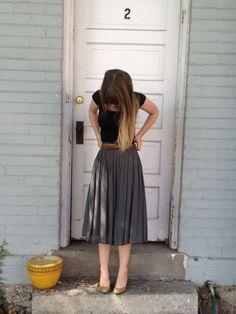 Grey pleated skirt + black top + cognac belt + nude pumps