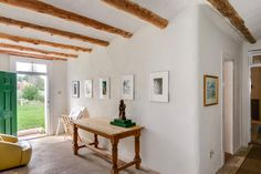 The house, which was once an inn, had been restored and remodeled by a previous owner. The Millers call the space shown here the 'little gallery.'