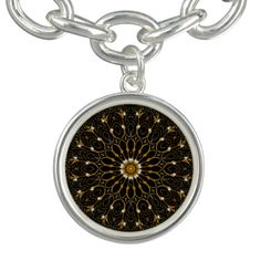 Black and gold filigree Victorian mandala pattern.