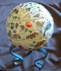 A tutorial on how to mosaic a styrofoam ball instead of a bowling ball to create a stunning art piece or a gazing ball using broken tile and jewelry.  The result is lightweight and easy to display.