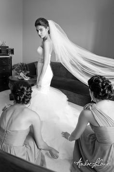 Wedding day preparations are underway as the bride puts on her dress | Andre LaCour Photography