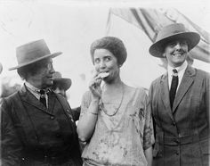 First Lady Grace Coolidge samples a Girl Scout Cookie, 1923