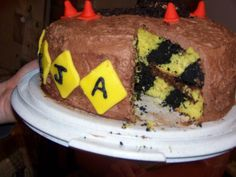 Construction birthday cake with caution tape inside. (Link Fixed)