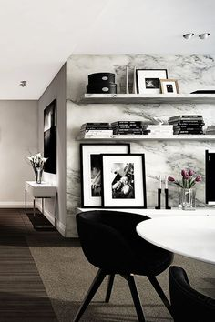 I love black + white leaning art against marble wall