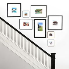 The Up-the-Stairs gallery wall maintains perfect vertical and horizontal through lines for a sleek stairwell design. Create your Up-the-Stairs gallery wall with Framebridge here! Stairway Photos, Stairway Gallery Wall, Stair Gallery, Gallery Wall Layout, Pictures On Stairs, Stairway Art, Hanging Pictures, Staircase Wall Decor, Picture Wall Staircase