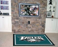 NFL - Philadelphia Eagles 5'x8' Rug  $199.99  http://sdsmarket.com  Show off your team pride in a big way! 5'x8' ultra plush area rugs won't leave any doubt about who you will be rooting for on game day! Non-skid backing keeps rug in place. Made of 32 ounce nylon carpet, which feels great on your feet. Chromojet printed i Features:  32 oz., 100% Nylon Face  Duragon latex backing for a durable and longer-lasting product  Machine made in the USA  Non-skid backing to ensure stability  Vacuum…