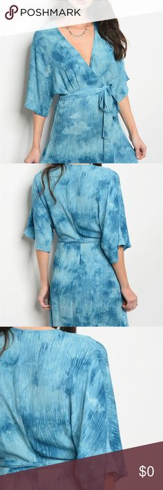 "BLUE WRAP DRESS 3/4 sleeve tie dye printed wrap dress that features a v neckline and waist tie. Fabric Content: 100% RAYON Size Scale: S-M-L Model Description: L: 34"" B: 40"" W: 24"" HONEY BELLE Dresses Mini"