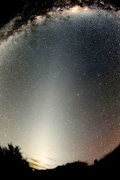 this triangle of light is actually Zodiacal Light, light reflected from interplanetary dust particles