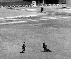 1971: East German border guards drag back an injured East German shot trying to flee. Between 1961 and 1989 around 5,000 people attempted to escape, resulting in an estimated 100-200 deaths. (Keystone)