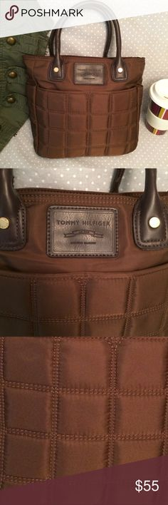 """Chocolate brown Tommy quilted purse + dreamy sheen What a fantastic little purse! Deep, rich brown material has a sleek, subtle sheen to it. Quilted-effect front gives interest. Gold hardware. Exterior side pockets, interior divided into three with middle zip pocket. Other pockets have smaller compartments. Black lining. Comfy leather handles the right length for hand, arm, or elbow (not shoulder): about 13.5"""". 12"""" wide, 10"""" tall, 3.5"""" deep. EUC; no marks or wear! Perfect for fall! 😍☕️🍂…"""