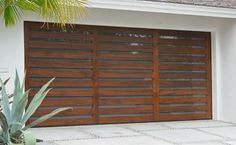 Did you remember to shut the garage door? Most smart garage door openers tell you if it's open or shut no matter where you are. A new garage door can boost your curb appeal and the value of your home. Cheap Garage Doors, Garage Door Windows, Diy Garage Door, Wood Garage Doors, Garage Door Makeover, Garage Door Design, Garage Ideas, Roll Up Garage Door, Timber Garage