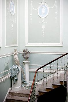 In BLIND FORTUNE, Lowden Hall's dining room is decorated with Wedgewood wall panels like these.