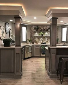 A brown kitchen with wood floors and granite to match.