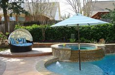 An elevated area near the spa provides the perfect area to sunbathe or have an additional patio set.