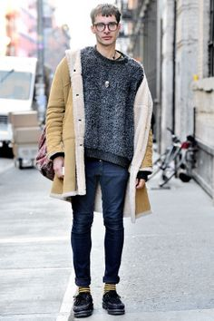Gadir (22 - Student) wears Glasses by Tom Ford, Sweater by Comme des Garçons, Coat by London Fog, Pants by Opening Ceremony, Shoes by Creepers. www.designerclothingfans.com