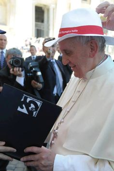 Pope Francis giving autographs