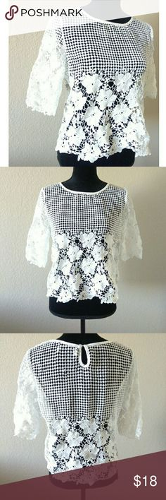 White Lace Overlay Crop Such a lovely top. White floral lace top. No stains or rips. Is missing tags to it. I'm guessing M to L in size. Approx length is 20 in. chest is 19 in.  Naturally loose fitting. Tops
