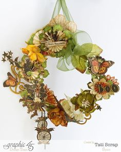 """What an amazing wreath from Graphic 45 team member TATI SCRAP.  She has created this masterpiece with """"An Eerie Tale"""" elements from G45 along with Botanica Flowers & Botanica berries along with Burlap flowers and Textured flowers from Petaloo too!  you can find this wreath on the Graphic 45 website.  http://www.Graphic45.typepad.com"""
