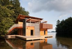 If vacation property costs too much. Build a killer houseboat. Muskoka Boathouse